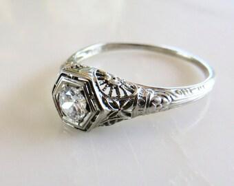 Circa 1930 18kt White Gold and Filigree 0.33 Carat VS2, G color Diamond Engagement  Ring.