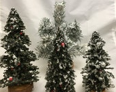 Four Vintage Bottle Brush Christmas Trees and Two White Picket Fence Sections with Red Bows