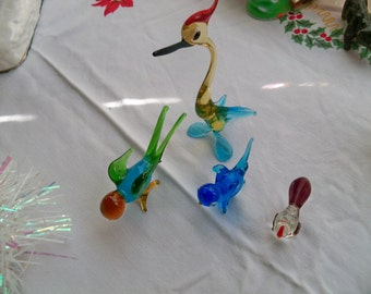 4 colorful glass  birds from the island of misfit birds two non broken two broken