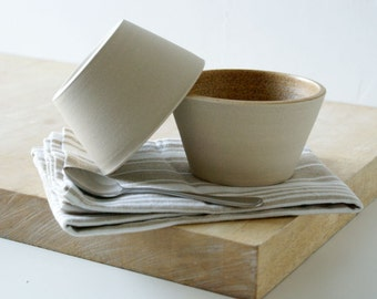 Set of two partly glazed snack bowls in white and natural brown - hand thrown pottery dishes