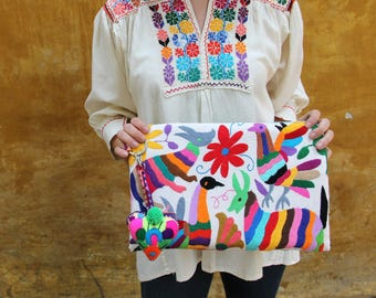 Otomi Multi colored clutch with hand embroidered tassels