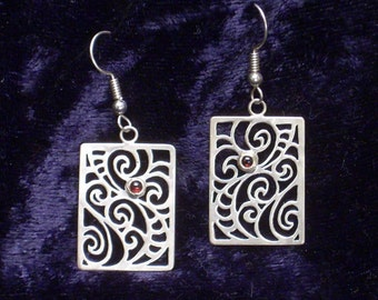 Saw pierced rectangular sterling silver earrings with garnets