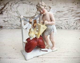 Vintage cupid fanning the heart porcelain figurine, angel statue, anatomical heart, love decor, Valentine's decor, Valentine's Day gift