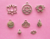 The lotus flower collection - 8 antique silver tone charms and spacer bead
