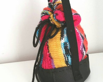 Hand knit and hand sewn leather bucket bag