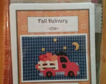 Fall Delivery, an adorable truck and pumpkin applique Tea Towel Kit  pattern with a terra cotta tea towel