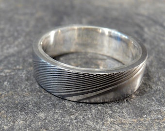 Over 50 PERCENT OFF- Damascus Stainless Steel Ring Lined With Sterling Silver, Wedding Band Hand Made