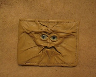 Grichels leather bi-fold wallet - sandy tan with green carousel horse eyes