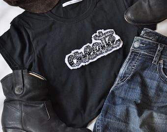 Create women's black t-shirt