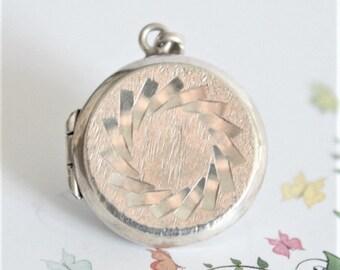 Vintage sterling silver locket.  Small round locket.  Etched locket