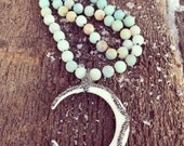 Crescent pave knotted necklace