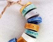 Immensity of the sea -- a set of 9 blue, white and golden small ceramic beads