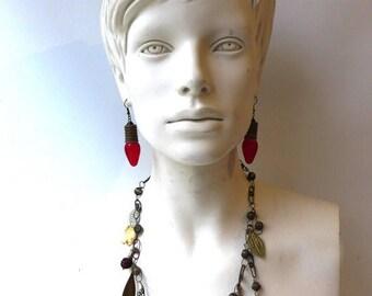 ON SALE Vintage original 1960s hippie boho elephant and metal leaf charm necklace