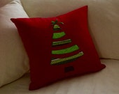 whimsical christmas tree pillow cover on red background