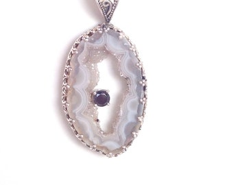 "Geode slice necklace made in sterling silver,  with a black zircon. It is on a 18"" sterling silver chain."