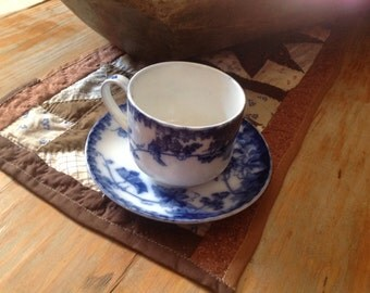 German flow blue cup and saucer