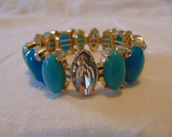 vintage FRAGMENTS mfg. bracelet gold plated blue light blue clear crystals expandable stretch