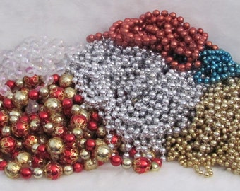 Lot of Five pounds (5) of strung beads for crafts supplies; red and gold, clear, silver, gold, red and blue-Christmas beads Craft beads