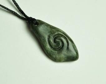Greenstone ~ Small New Zealand Pounamu river stone with koru engraving. Maori tribal pendant