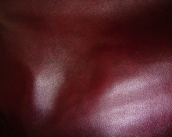 "ECONOMY Leather 12""x12"" (new lighter shade) Ox Blood Economy UPHOLSTERY Cowhide  2.5-3 oz /1-1.2 mm  may have permanent wrinkles"