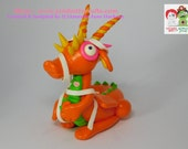 Tango Two Toes!. Orange Cumzie Dragon. Hand Sculpted Polymer Clay Figurine