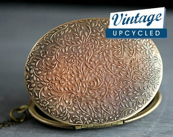 Very rare large oval vintage locket. Gorgeous statement locket necklace. Color gradation from dark bronze to gold. Locket necklace.
