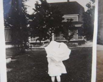 Vintage Snapshot Photo - Rear View - Little Girl in White With Umbrella