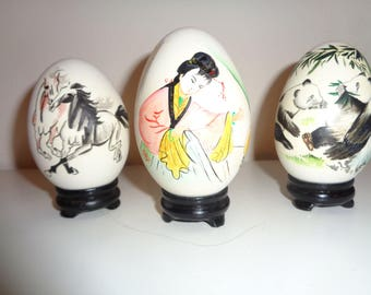 3 Hand Painted Asian Ceramic Eggs with delicate, dramatic depiction of two wild horses, a pair of pandas and an elegant Geisha in Good Shape