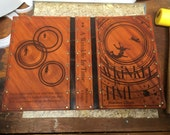 "Leather covered copy of the ""Wrinkle in Time"" trilogy by Madeleine L'Engle"