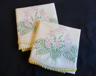 Vintage Standard size lt cream color pillowcases with hand embroidered violets, hand crocheted lace edging.