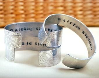 sisters bracelet - big sister middle sister little sister- Aluminium cuff - Silver tone bracelet - Embossed Bangle