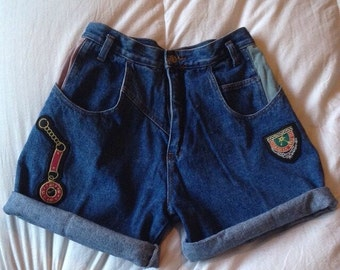 Adorable pair of Vintage jean shorts with original patches, pink pocket watch, etc