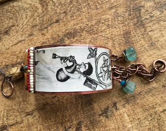 Rustic '  Medieval Bagpipes Musician ' bracelet . assemblage mixed media . collage . rest coat . rustic . bohemian . vintage image . music