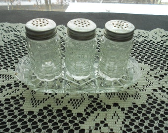 Vintage  cut glass salt and pepper shakers square cut glass with Anchor Hocking butter dish bottom.