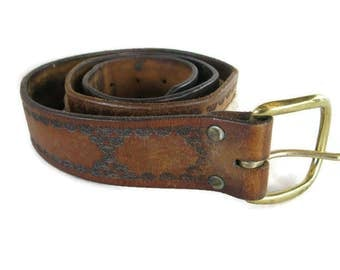 vintage brown hand tooled leather belt with braided cord sections and brass buckle