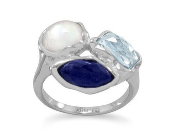 Rhodium plated sterling silver ring with faceted sky blue topaz, clear quartz over mother of pearl, and clear quartz over lapis 83667