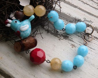 Cherry Thief- artisan lampwork bird. rustic summer bracelet. turquoise red yellow brown. wood. Indie style. boho jewelry. jettabugjewelry