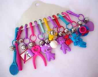Vintage 80s Twelve 12 Colorful Plastic Bell Charms New Old Stock (NOS) Notepad Phone Cup Saucer Googly Eyes Cat Dog Bear Wrench Bat Baseball
