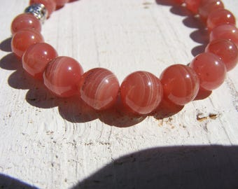 RHODOCROSITE BRACELET, Beautiful AAA, Gem quality! On stretch cord