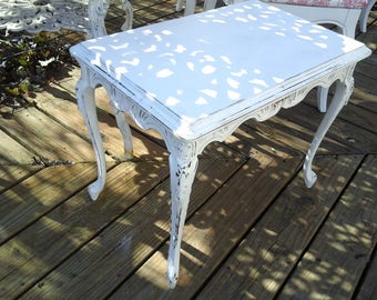 petite french carved coffee table