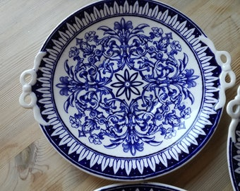 A set of 3 blue and white vintage wall plates