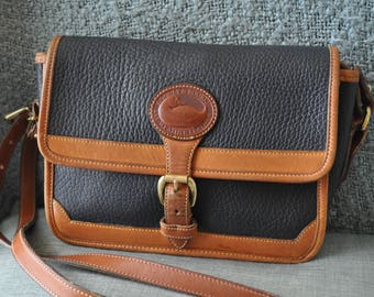 Dooney and Bourke Navy and British Tan Pebbled Leather Crossbody Purse
