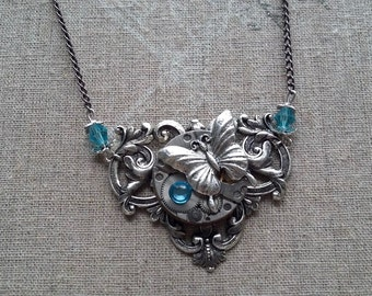 Necklace pendant Butterfly steampunk with a watch mechanism