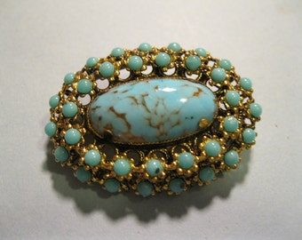 austria turquoise glass brooch gold tone metal