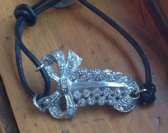 Vintage Rhinestone Assemblage Bracelet Hand Made Bow Charm Repurposed Button 30s Art Nouveau Dress Clip Black Leather Wrap WishAnWear