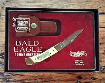 American Bald Eagle Commemorative Pocket Knife by Schrade Cutlery 1982 Limited Edition with Scrimshaw Eagle NIB with leather pouch
