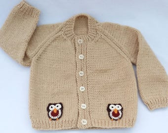 Baby sweater. Hand knitted beige baby cardigan to fit a 6 to 12 months baby. Baby clothes, baby gift, baby shower.