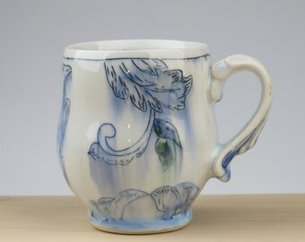 Porcelain toile pattern mug with ornate handle