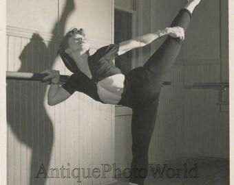Pretty woman ballet dancer stretching vintage dance photo
