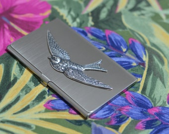 silver tone business card case with flying bird